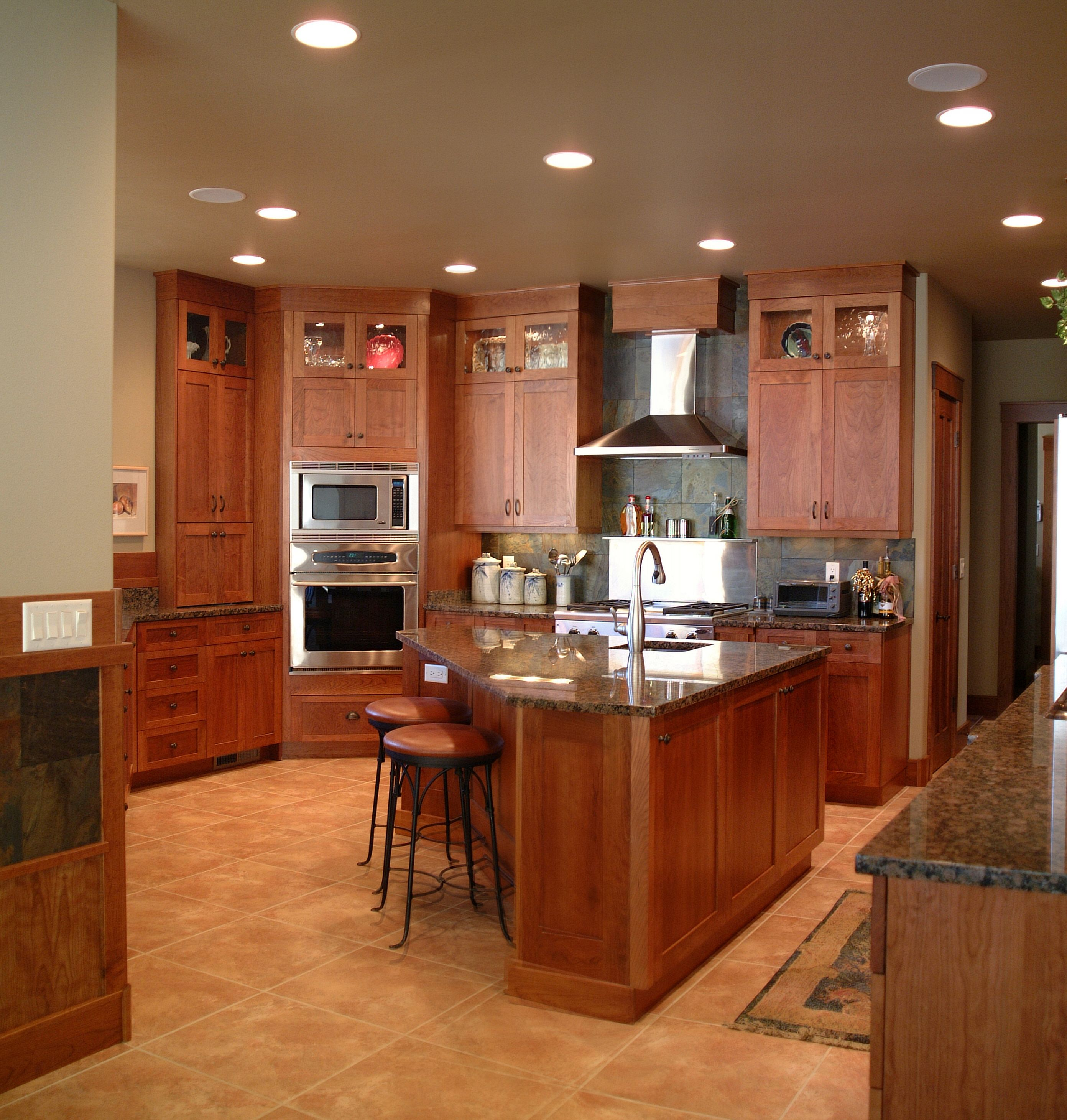Kitchen Triangle With Island warm, inviting kitchen with high display cabinets, triangle shaped