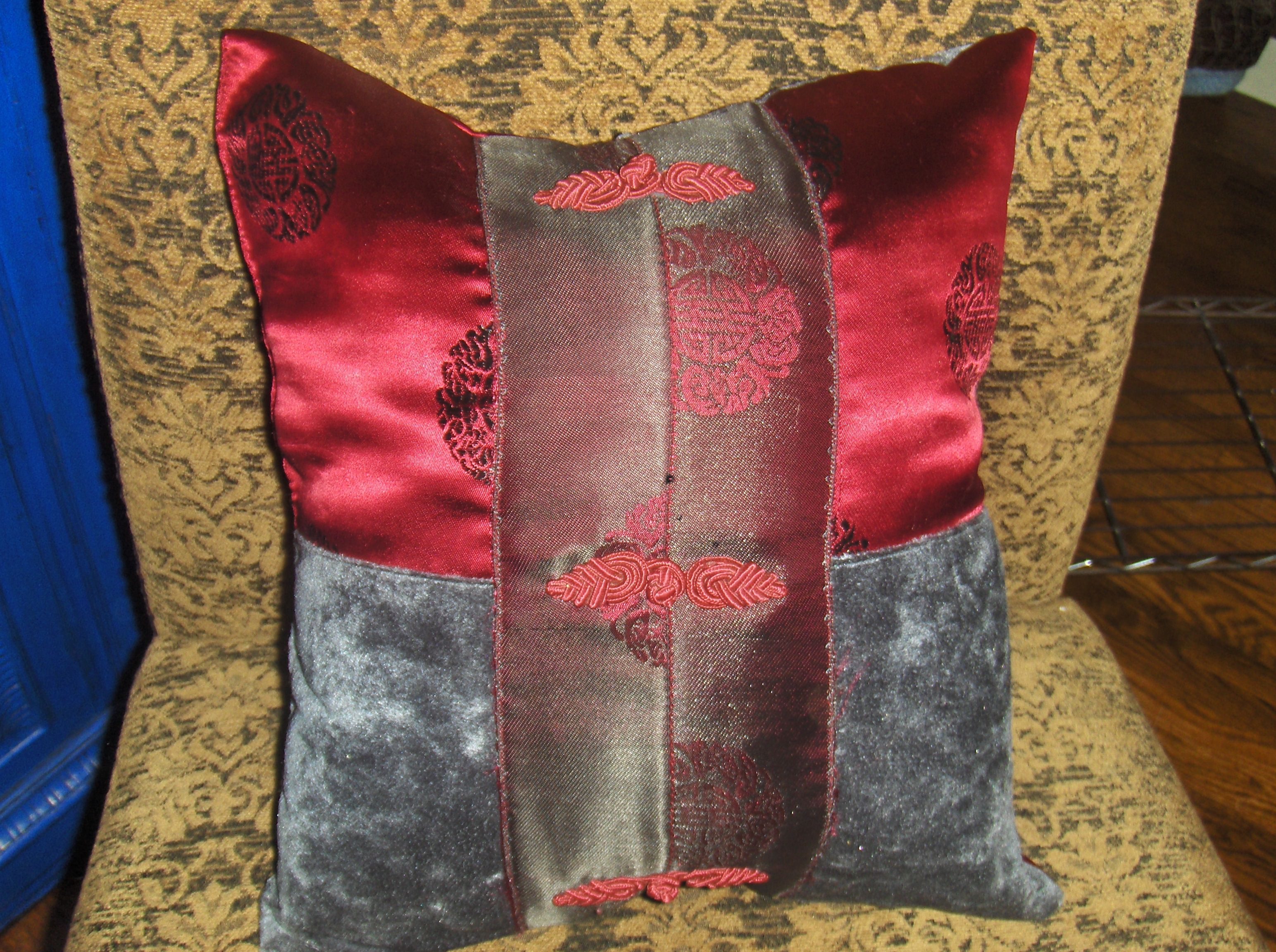 Recycling - left over fabrics, saving old dresses etc. and reusing fabric from cuttings to make beautiful one-of-a-kind pillows, this red-grey pillow was bought by a customer for her daughter's room