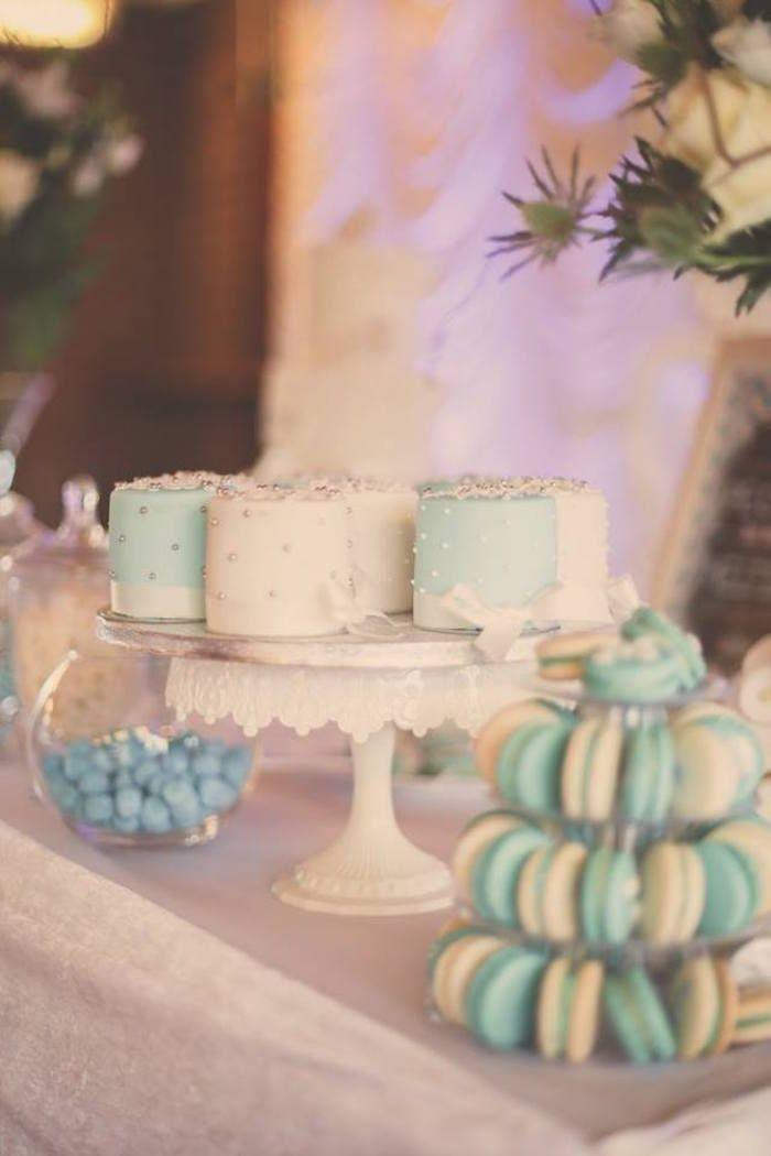 Adorable white and blue snowflake adorned mini cakes! Frozen Winter Birthday Party
