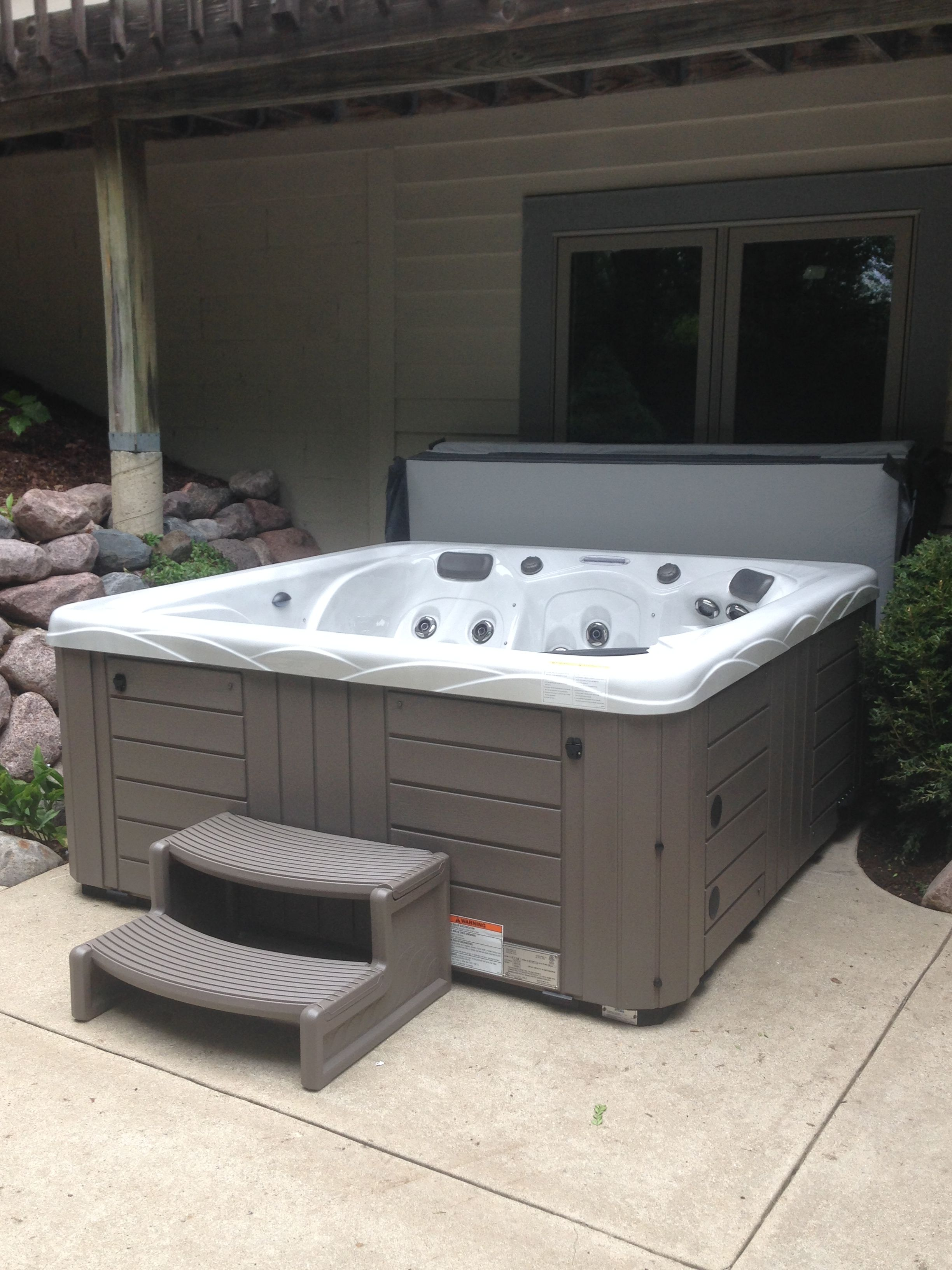hight resolution of here is a master spas twilight series installed on a concrete slab under the deck