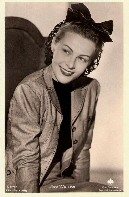 """""""Dutch-born actress and singer Ilse Werner (1921-2005) was one of the most popular stars of the German screen during the Nazi years. After the war she became a successful Schlager singer. Her nickname, Ein Frau mit Pfiff, translates as A Woman of Distinction, but also refers to her trademark, """"whistling."""""""