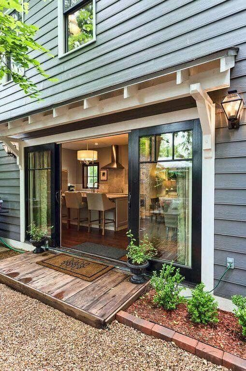 The Slide To Outside 7 Ways To Use Sliding Glass Doors In Your Home Decor 1920s House House Exterior Modern Farmhouse Exterior