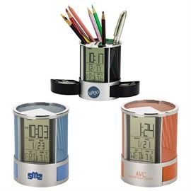 Clock/Organizer  Jumbo LCD music alarm clock with day/date calendar and thermometer. Colored metal mesh pen cup with 2 spring loaded hide away storage drawers. 2 x AG13 batteries included.