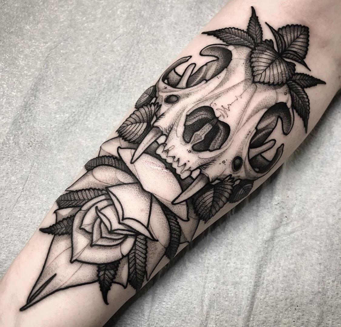 Cat skull with catnip rose and hemp leaves artist richard