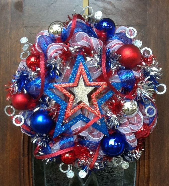 Glittery 4th of July Wreath with a large red, white and silver star in the center to show your Patriotism. $125.00, via Etsy.