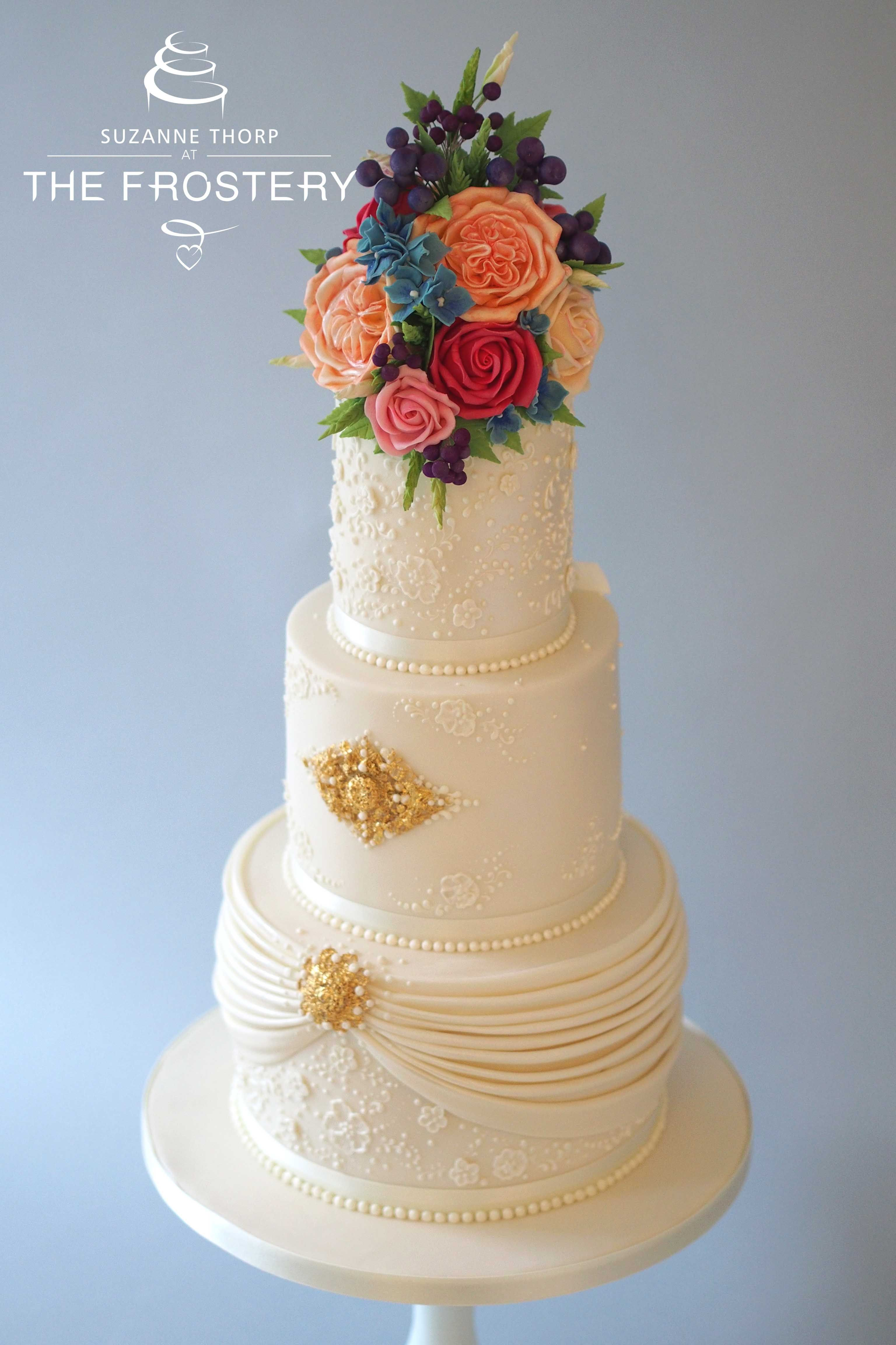 Three Tier Wedding Cake Topped With Sugar Flowers In Bright And Bold Exotic Hues At Peckforton