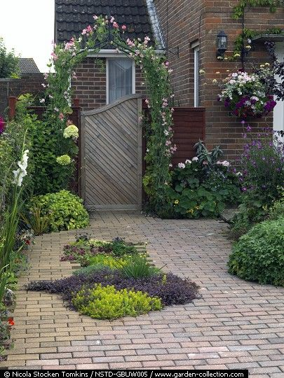 small front garden is paved for off