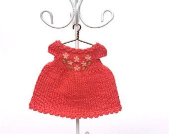 Doll clothing dress created for 3.5-4 doll (9.5-10 cm). Dress made of high quality yarn (50% wool, 50% acrylic). Dress decorated by crochet flower and miniature white button on the back.  Size: length approximately 5.5 cm (2.17)  Real color tint depends of computer display. It can be a bit brighter or paler