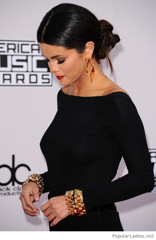 Simple Black Dress With Golden Accessories Selena Gomez Style Sleek Updo Sleek Hairstyles