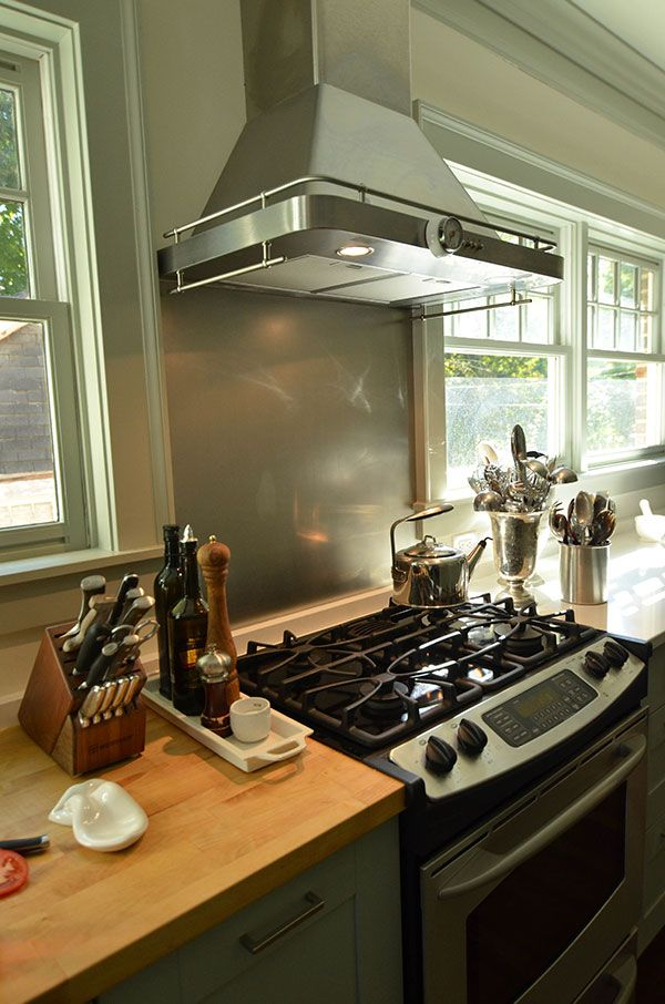 A Slab Of Butcher Block Countertop Next To The Stove Makes It Easy To Chop  And