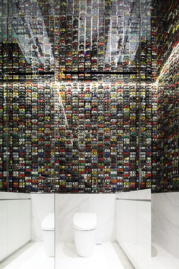 toy cars on bathroom wall at new lexus store intersect by lexus design by wonderwall. beautiful ideas. Home Design Ideas