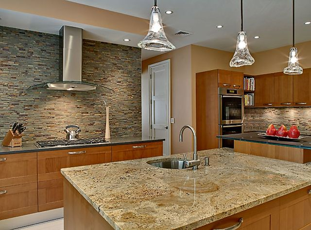 White Macaubas Quartzite countertops with white cabinets, a dark ...