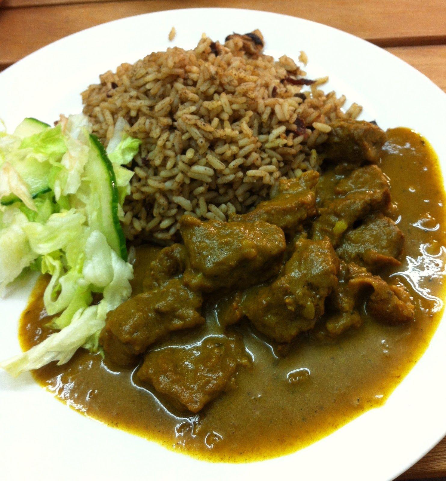 curry goat with rice  peas  jamaican cuisine jamaican
