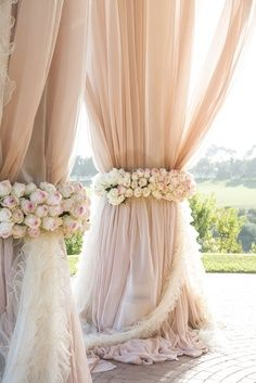 Blush curtains and flowers.
