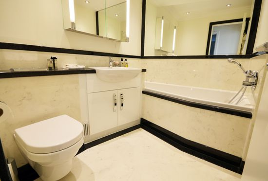 These bathroom designs make excellent use of space to create gorgeous  luxury bathrooms for this penthouse apartment in Manchester. Custom  surfaces to order.