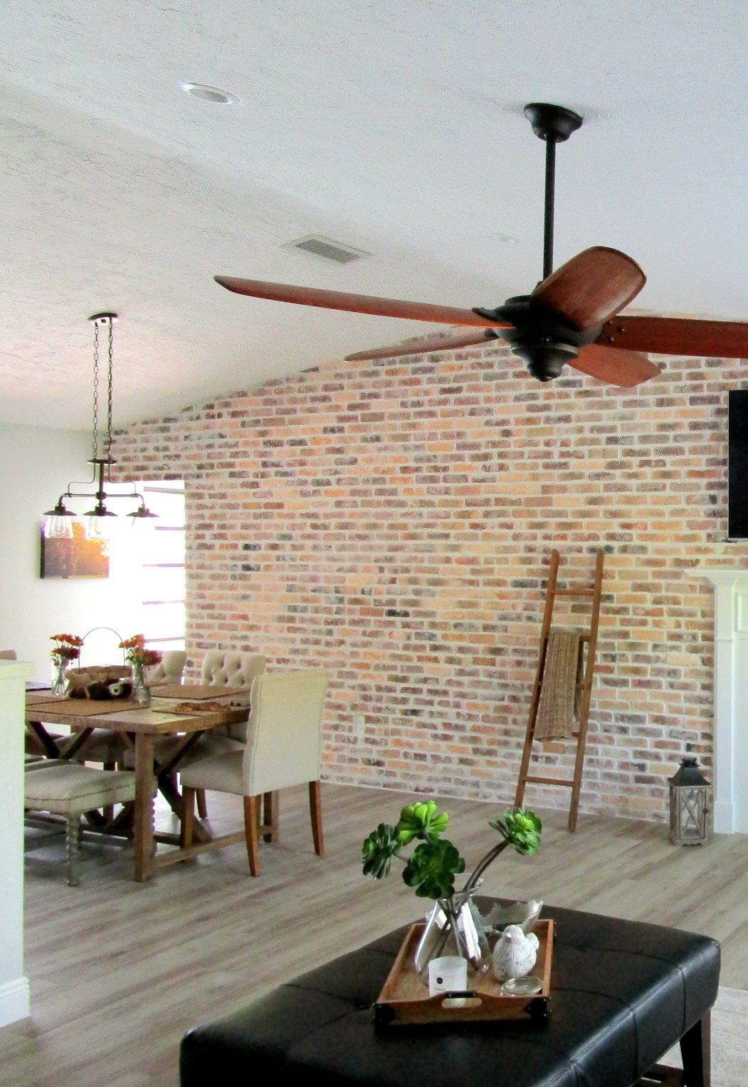 A cozy space with a brick accent wall mortonstones brick tiles