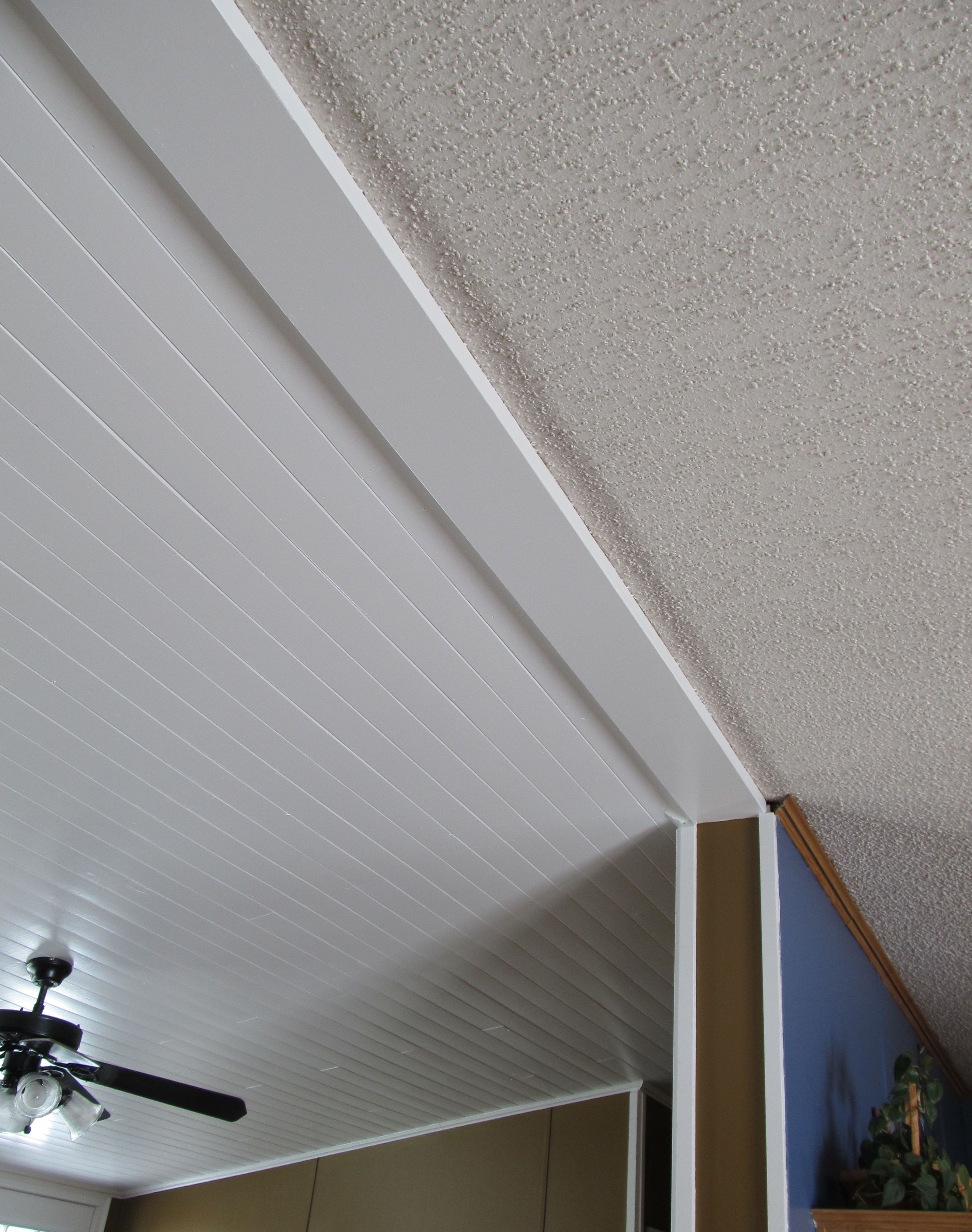 Diy Plank Ceiling Vs Popcorn Ceiling This Shows The New White Planking In The Living Room Against The Popcorn Ceiling In My Dining R Home Salon Home Remodeling Ceiling