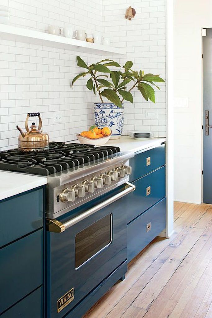 Switching out your upper cabinets for shelving opens up your space