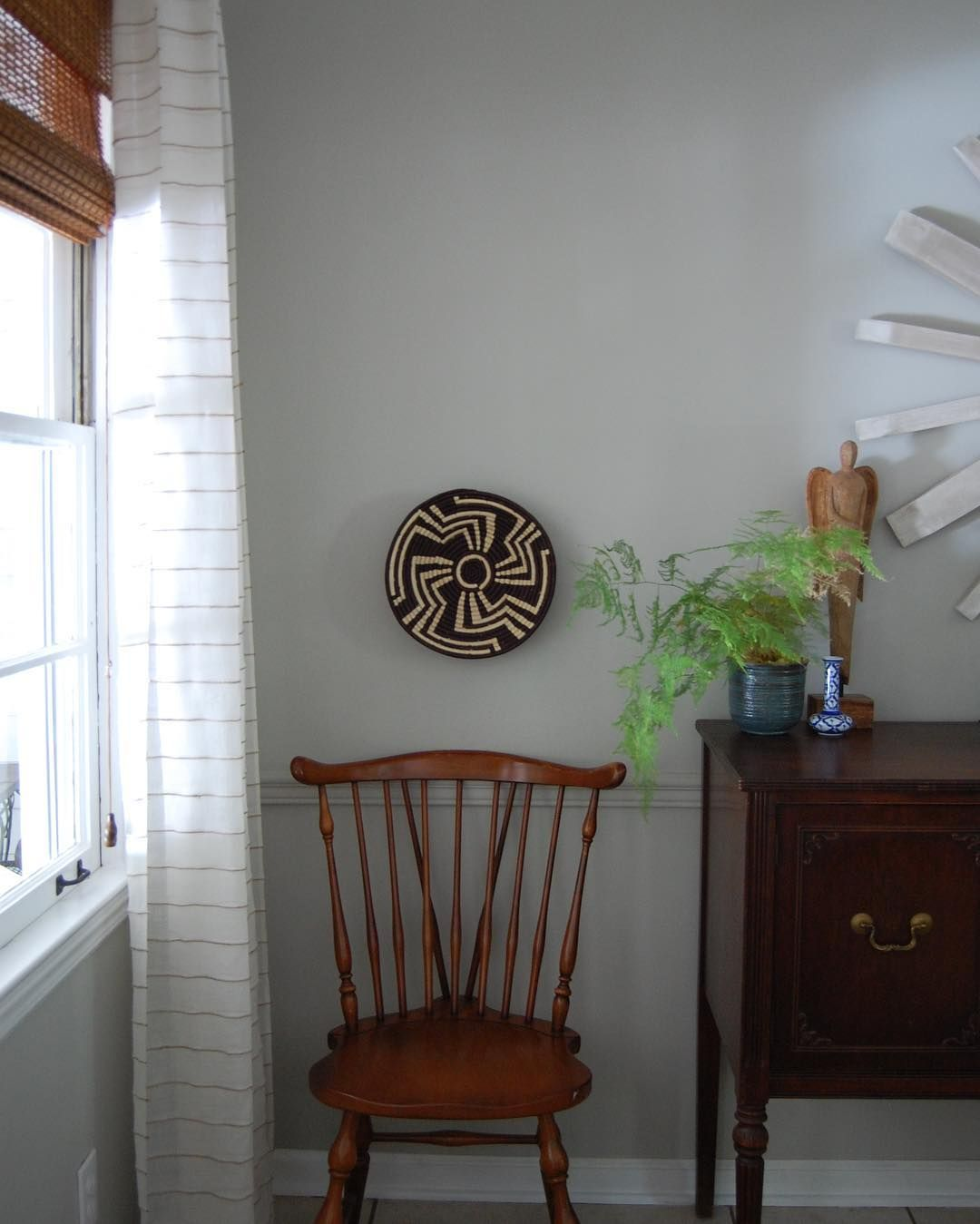 Eclectic Traditional Dining Room Decor With African Basket And Fern