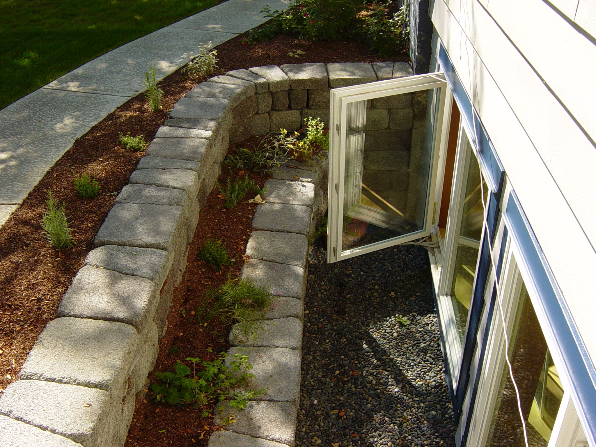 Tiered egress window well Safe escape route lots of light and