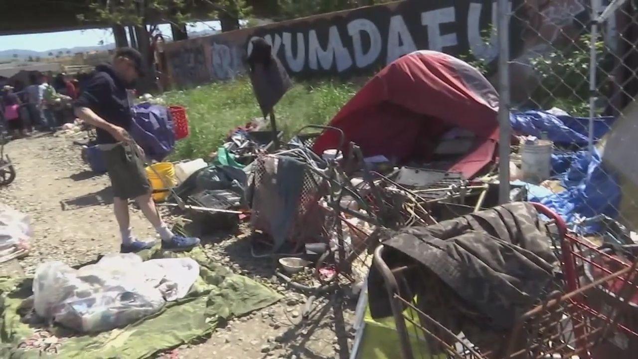 Volunteers cleanup San Jose homeless encampment San