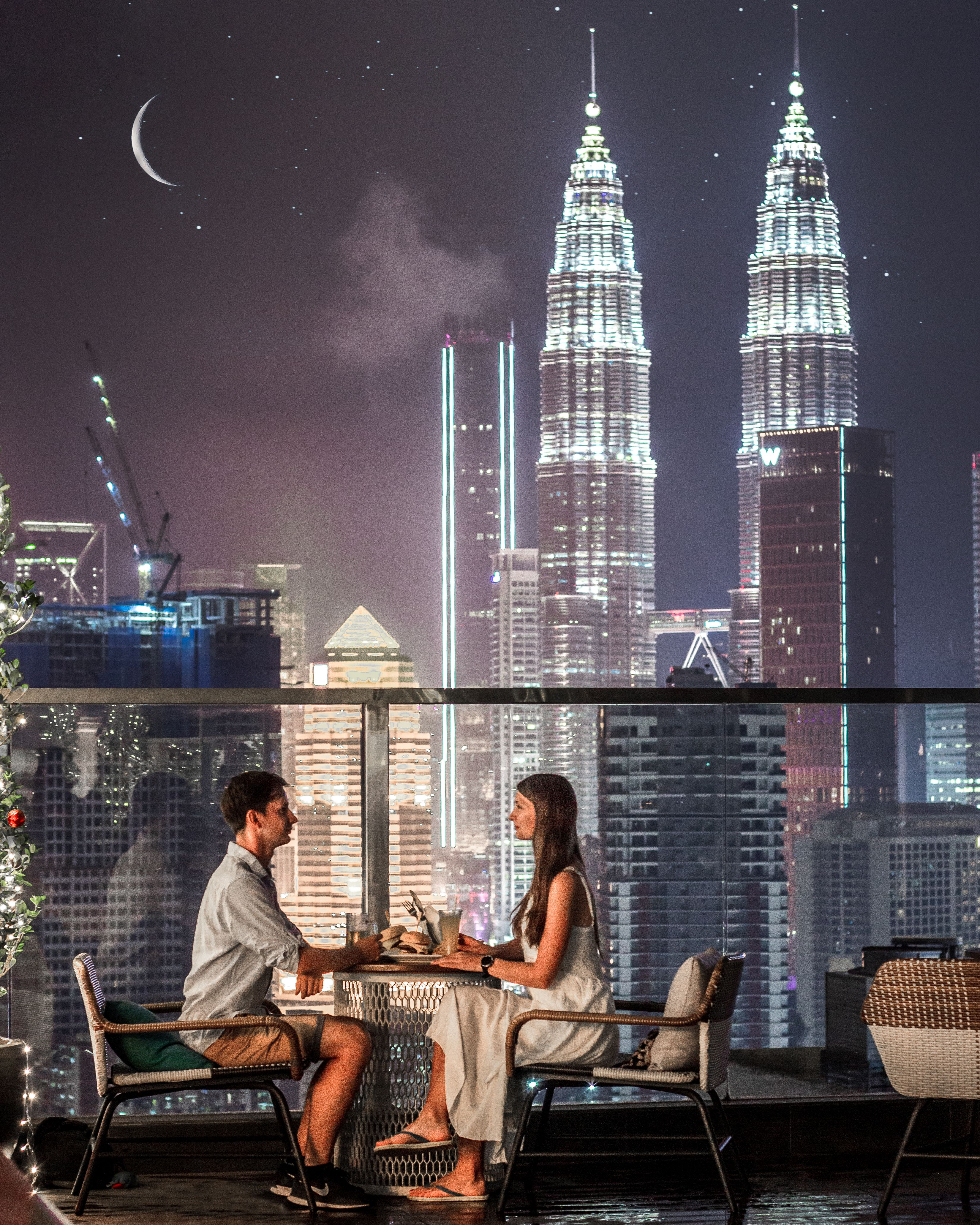 Romantic dinner in rooftop restaurant in Hilton Garden Inn