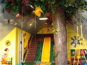 My kids are so having a room like this: tree swings, slide & rock wall!