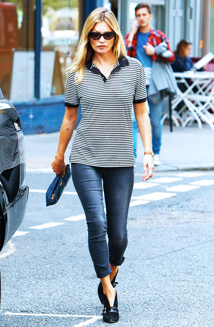 Kate Moss in a striped polo, cuffed jeans, and black pumps