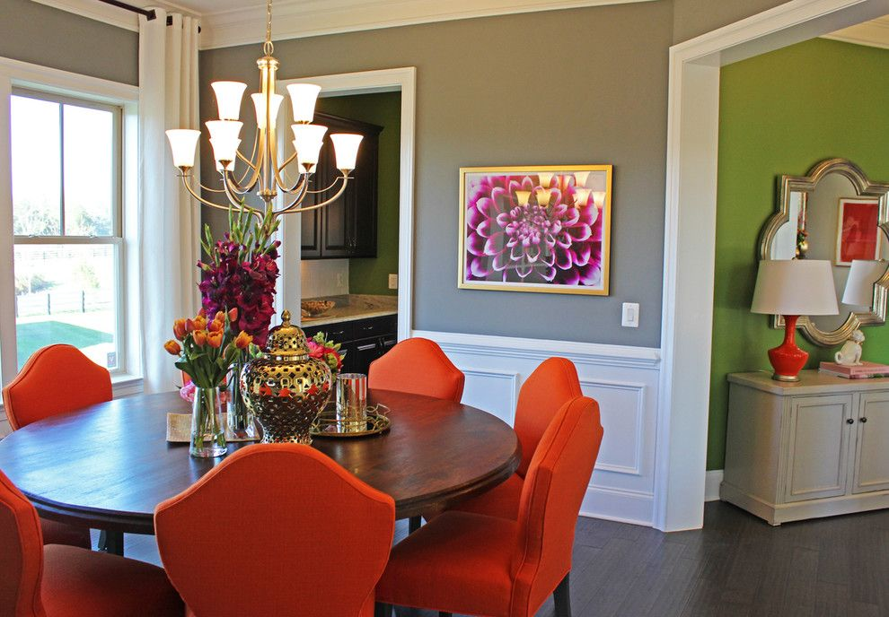 Bold Orange Chairs Bring Life To This Dining Room Let Bright Colors Turn Up The Volume In Your Home