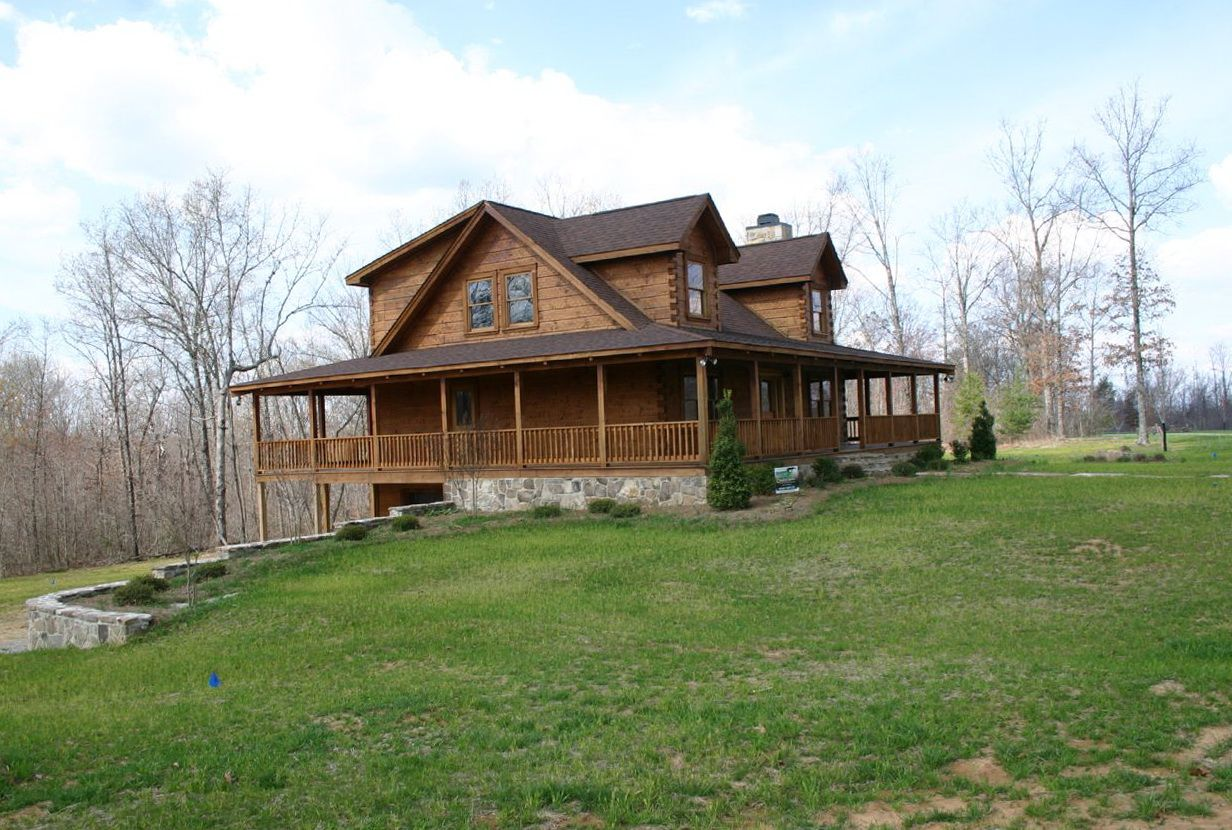 Log homes with wrap around porches homes i like for Cabin wrap around porch