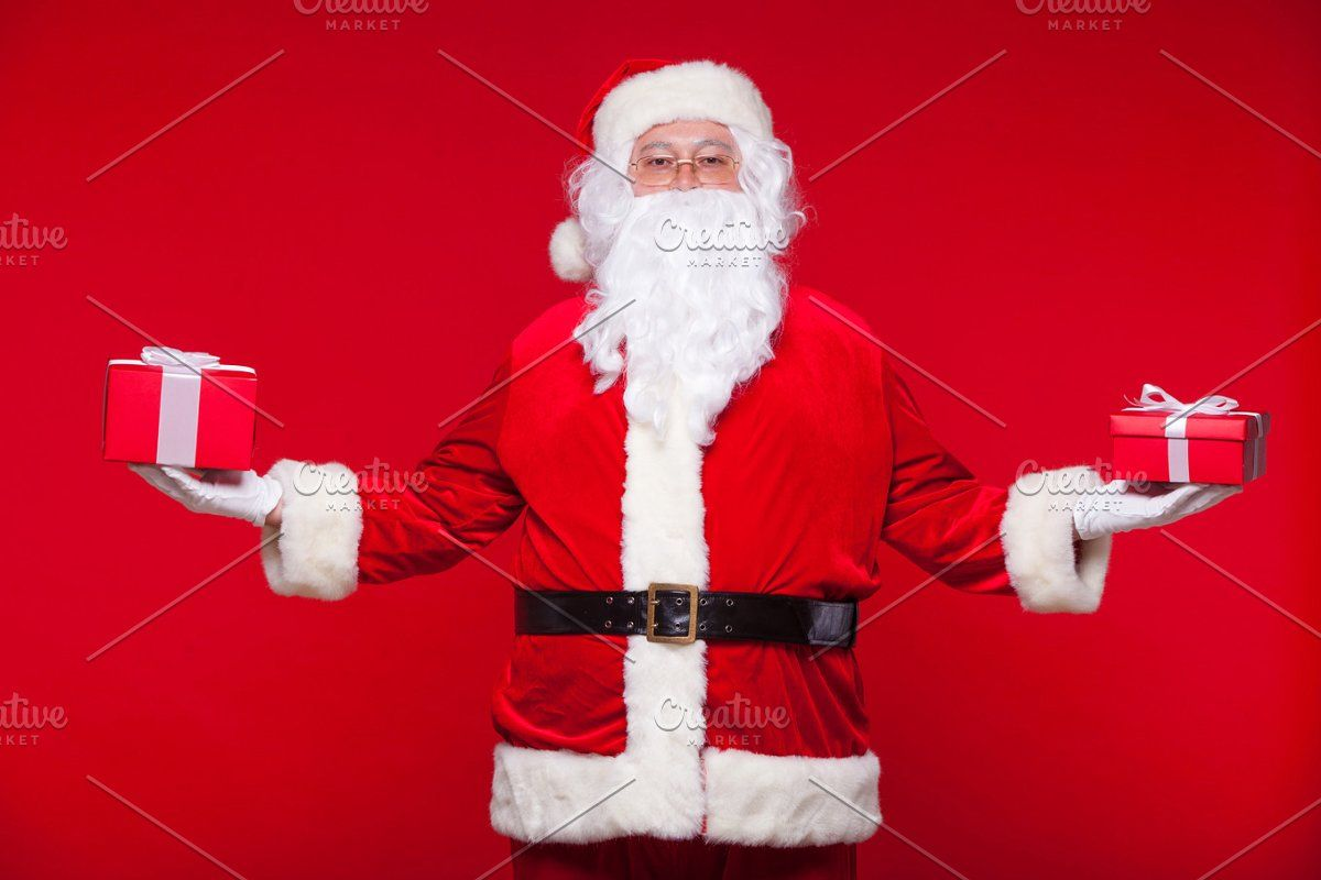 Christmas Photo Santa Claus Giving Xmas Present And Looking At Camera On A Red Background In 2020 Red Background Xmas Presents Santa Claus