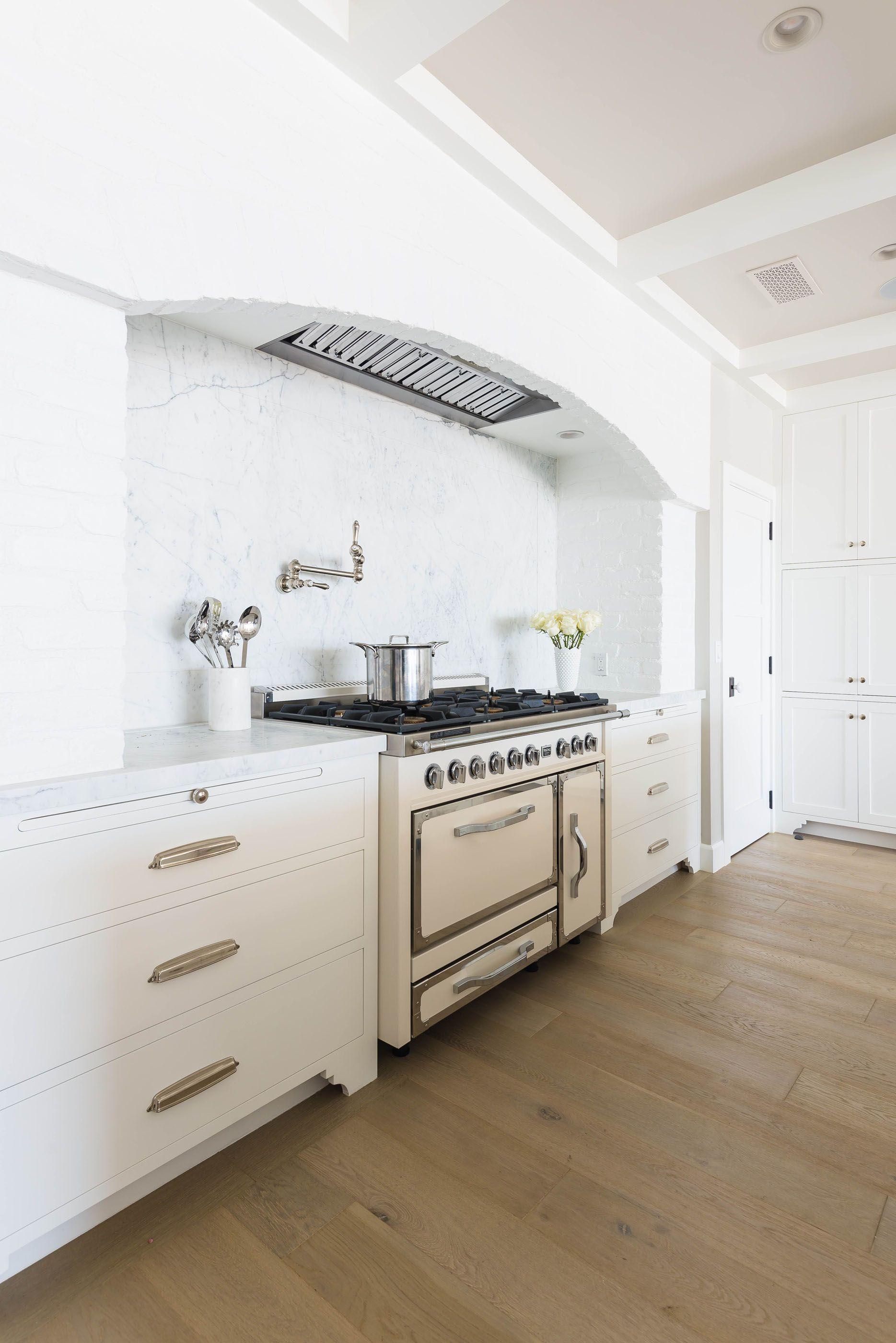 Marble Backsplash White Cabinetry Brass Pulls Melissa Morgan