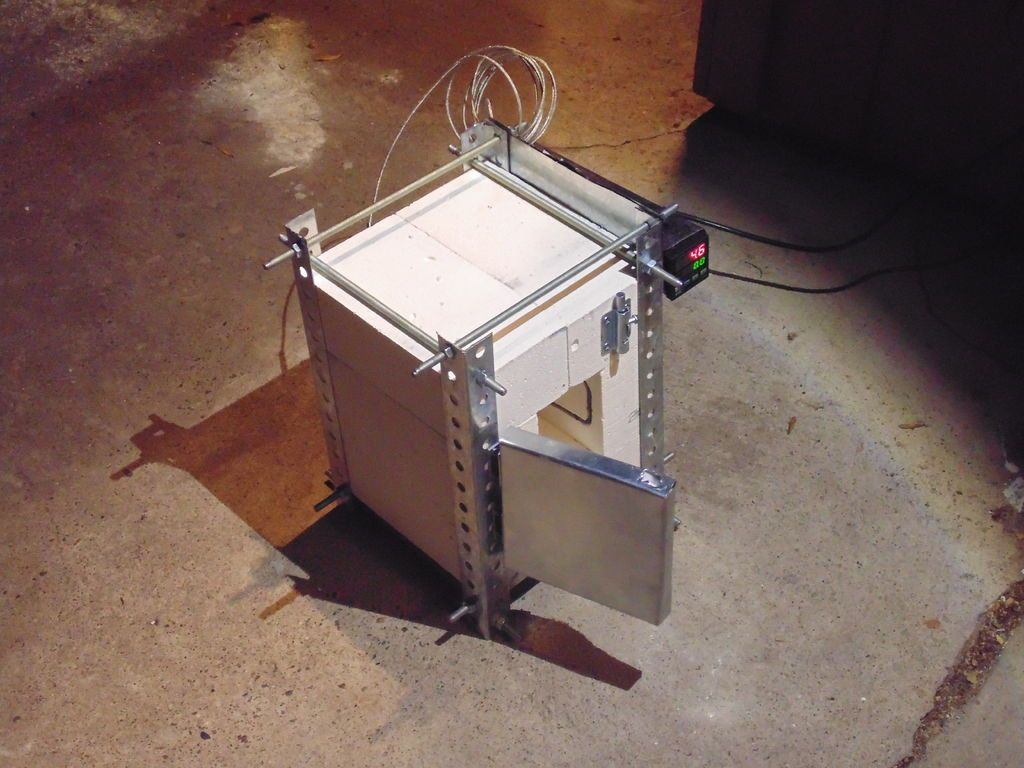 Homemade electric kiln, build for about $150. Goes up to 2000 F, can do silver.