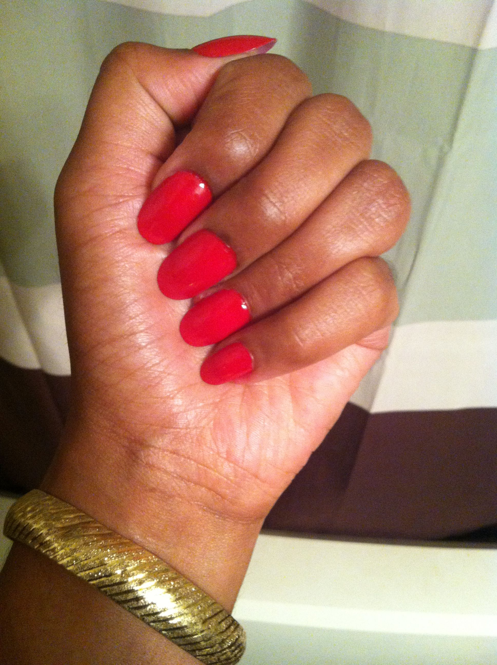 Red oval nails...these are actually press ons that I painted True ...