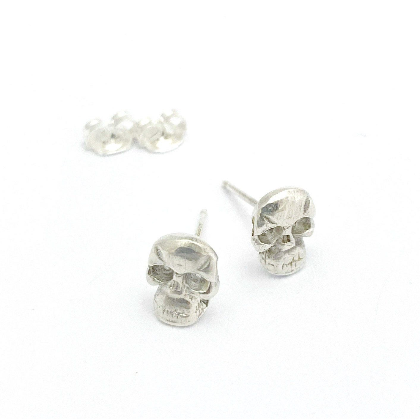 """""""Trendy sterling silver skull jewelry set: Silver skull pendant on a blackened silver layered necklace, and 2 tiny skull studs. This gorgeous set consists of a necklace and earrings: Silver skull pendant hanging from an oxidized chain necklace, and 2 matching skull stud earrings. It will look chic with your little black dress or with your favorite jeans and t-shirt. You can wear on its own for a light gothic look or through in other jewelry to get a total boho-chic vibe. Add this set to your col"""