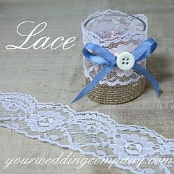 White Scalloped Lace - Lace is the perfect accent for rustic or vintage-themed weddings. Use it on candles, table runners, cakes, vases or bouquet handles. http://www.yourweddingcompany.com