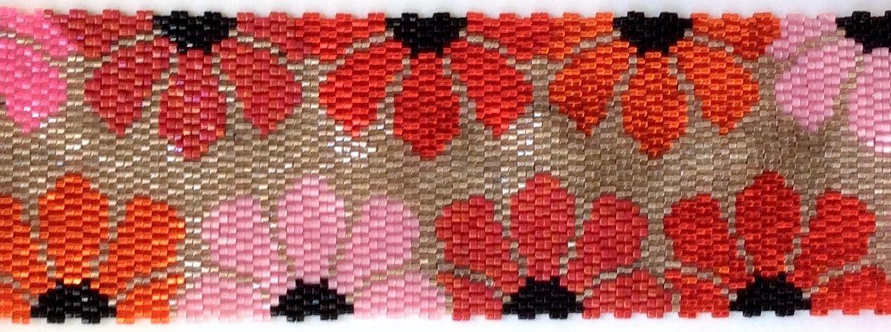 Bracelet manchette collection seventies à fleurs rouge et roses