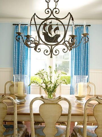 Nautical Dining Room Paying Homage To Nantuckets Maritime History Ships Appear On Both The Dramatic Iron Chandelier And Elegant Chair Cushions