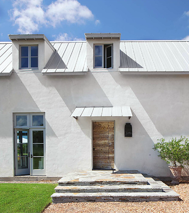 This White Modern Farmhouse Stucco Exterior And Metal Roof Kirby Mears For Eleanor Cummings Is A F Farmhouse Style Exterior House Exterior Farmhouse Exterior