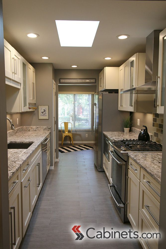 A beautiful galley kitchen featuring our deerfield for Ideas to redo old kitchen cabinets