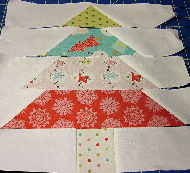 patchwork Christmas tree. I could make a large one of these as a wall hanging and sew velcro on for velcro decorations for the kids