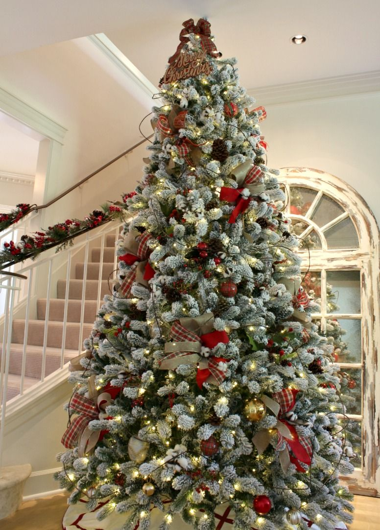 Flocked Christmas Tree Is Gorgeously Decorated With Ribbon And Traditional El Christmas Tree Decorating Tips Flocked Christmas Trees Traditional Christmas Tree