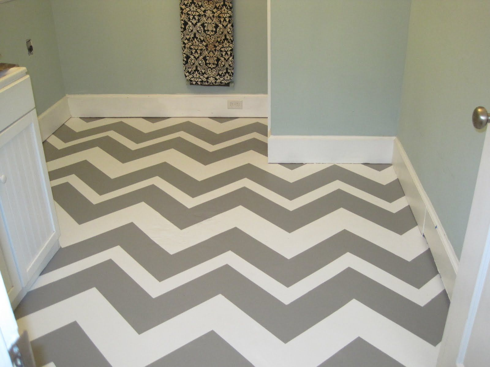Chevron painted concrete floor in laundry room High impact stylish