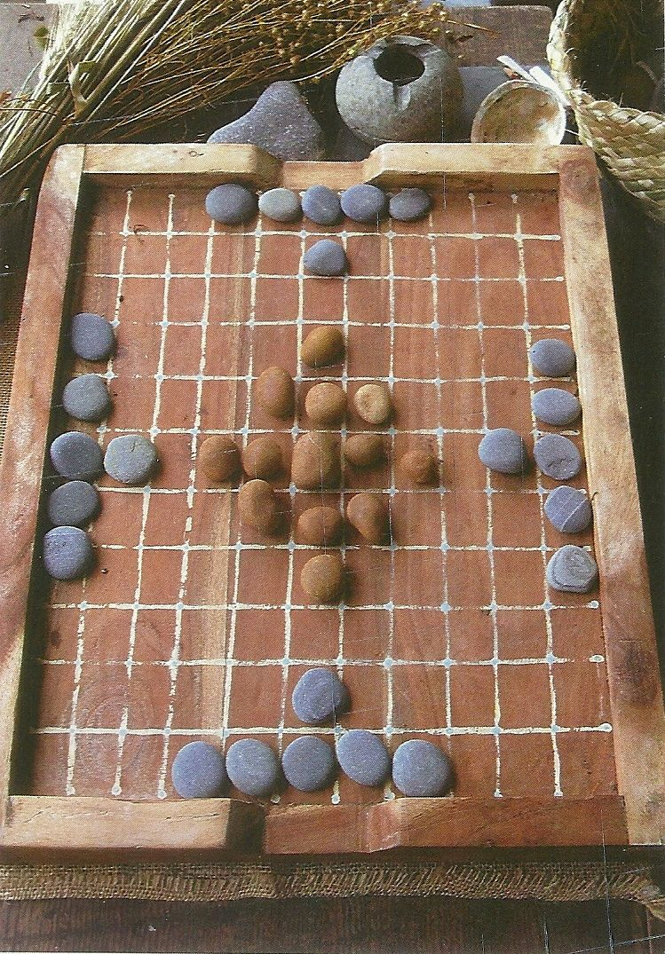 Play hnefatafl online. Here's an interesting site. You can