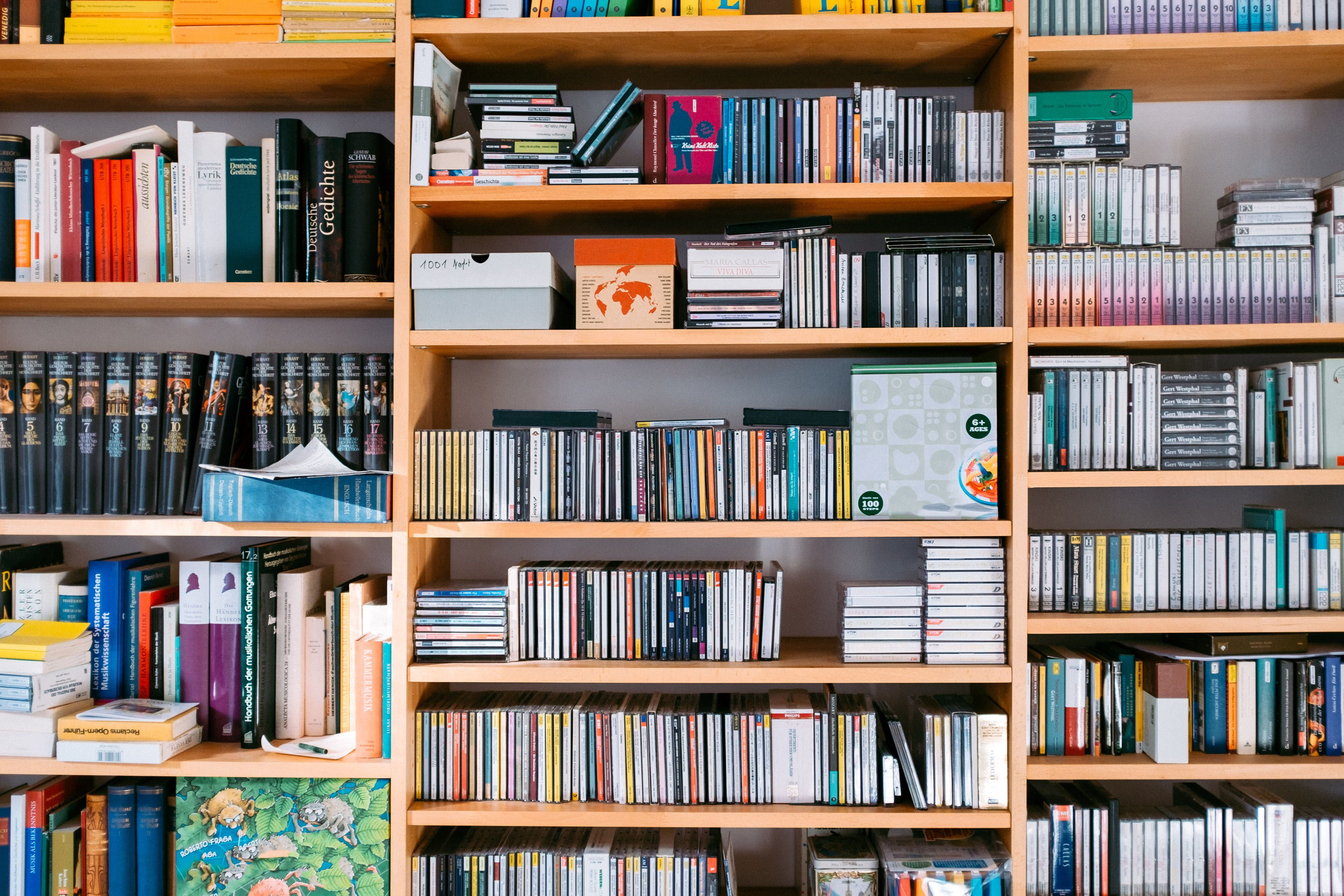 Bookshelf With Books And Cds Background Bookcase Bookstore Wallpaper Wallpaper Bookshelf Bookcase Wallpaper Bookcase