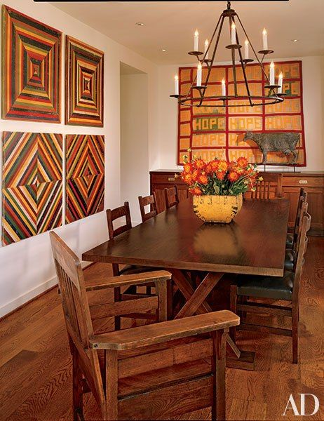 Midcentury painted wood panels from Missouri hang in the dining room of this Los Angeles–area home.