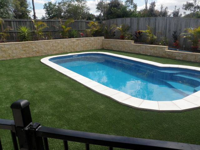 Pool surrounds fake grass lawns garden ideas for Swimming pool surrounds design