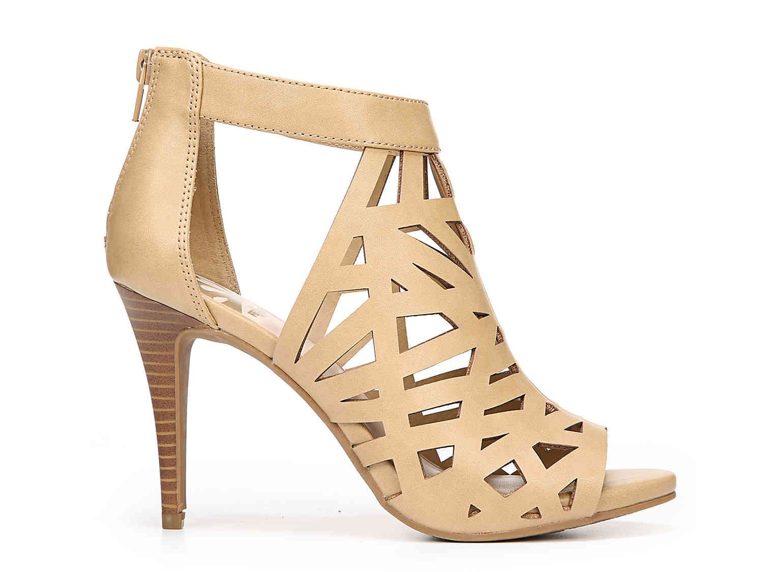 Make them look twice with the sexy Huddle Dress Sandal from Fergalicious.