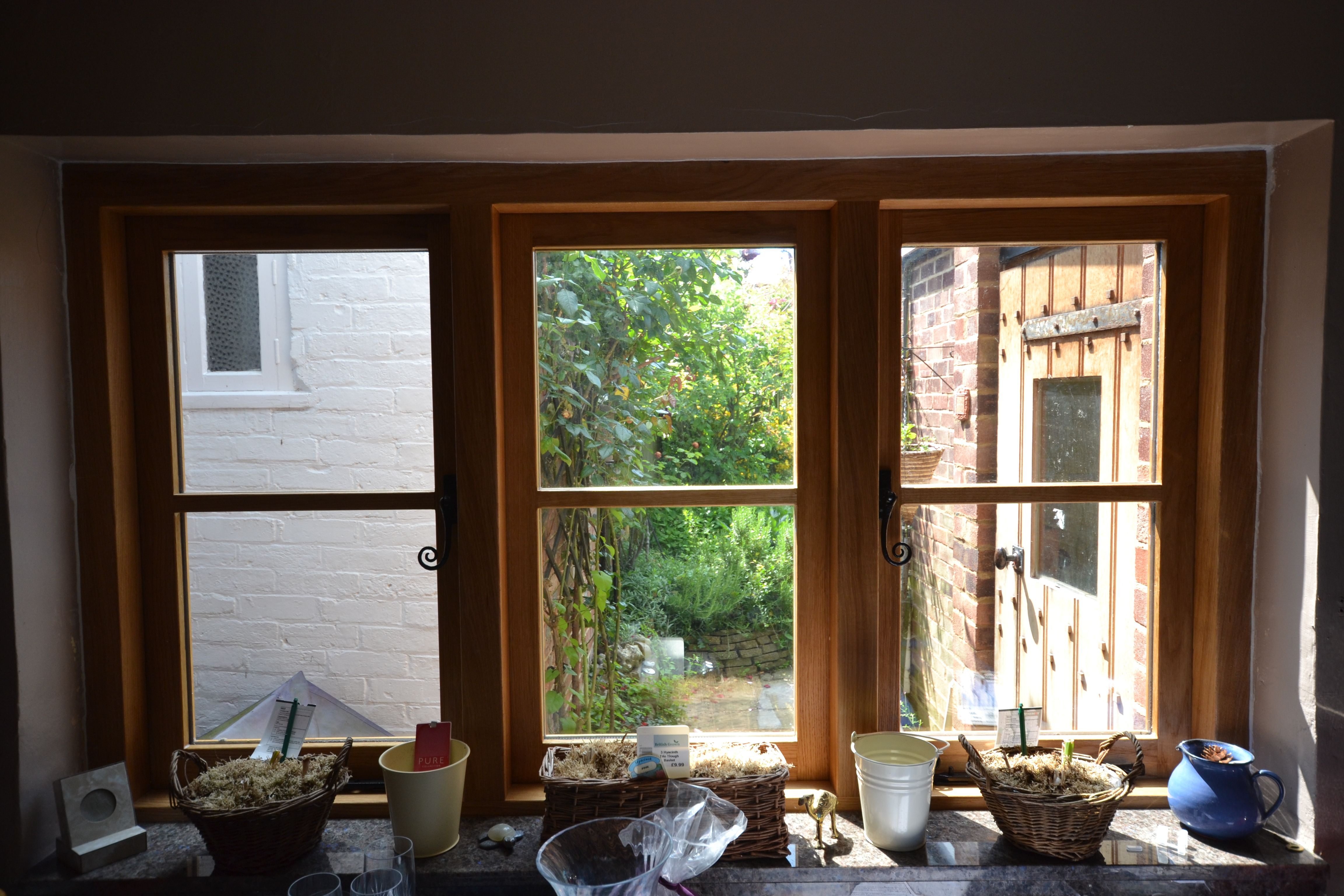 Purpose built and hand crafted windows to bring light into this classic country kitchen. #windows #light #bespoke