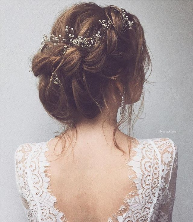 65 New Romantic Long Bridal Wedding Hairstyles To Try: A Whimsical Braided Up-do With Baby's Breath Woven In